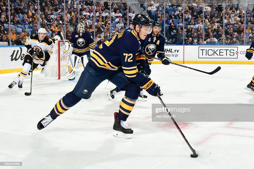 Tage Thompson of the Buffalo Sabres skates against the Boston Bruins