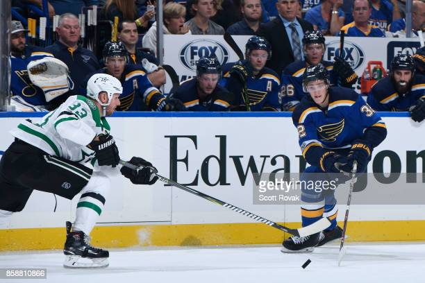 Tage Thompson of the St Louis Blues and Marc Methot of the Dallas Stars battle for the puck on October 7 2017 at Scottrade Center in St Louis Missouri