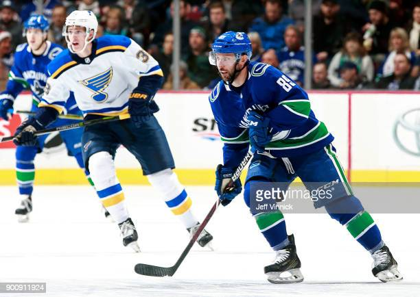 Tage Thompson of the St Louis Blues and Sam Gagner of the Vancouver Canucks skate up ice during their NHL game at Rogers Arena December 23 2017 in...