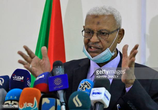 Tagelsir al-Hebr, Sudan's Attorney General, speaks during a press conference in the capital Khartoum on June 15 to announce the discovery of a mass...