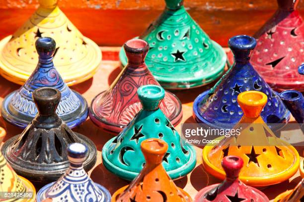 Tagines on a stand at a souk in Marrakech, Morocco, North Africa.