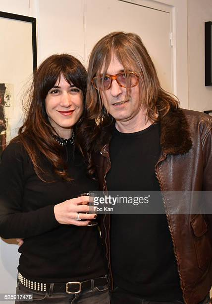 Taglialatella Galerie Paris director Nadege Buffe and Painter/musician/singer Pierre Emery from Ultra Orange band attend the 'As Hard' Pierre Emery...