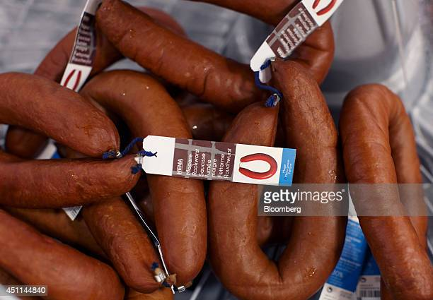Tags sit attached to Magere Rookworst smoked sausages in the delicatessen inside a Hema store in Utrecht, Netherlands, on Tuesday, June 24, 2014....