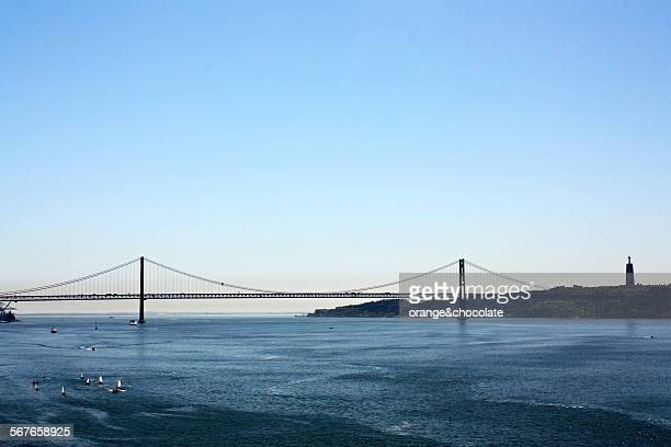 tagus river. lisbon. portugal - suspension bridge stock photos and pictures