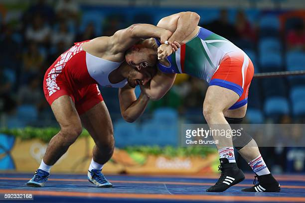 Taha Akgul of Turkey and Komeil Nemat Ghasemi of the Islamic Republic of Iran compete during the Men's Freestyle 125kg Gold Medal bout on Day 15 of...