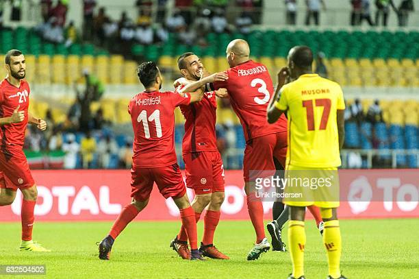 Taha Khenissi Naim Sliti and Aymen Abdennour of Tunisia celebrates scoring to make 10 during the African Nations Cup match between Zimbabwe and...