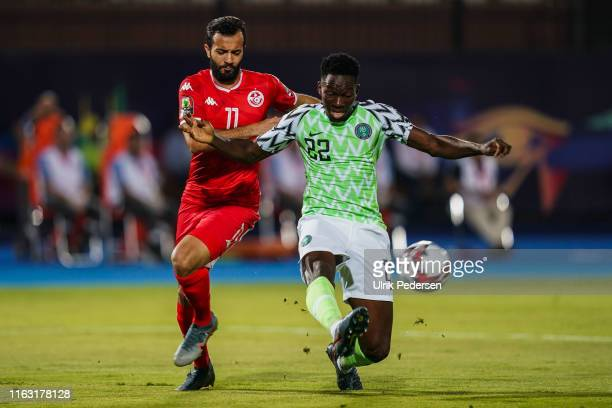 Taha Yassine Khnissi of Tunisia and Kenneth Josiah omeruo of Nigeria during the 3rd place African Nations Cup match between Tunisia and Nigeria on...