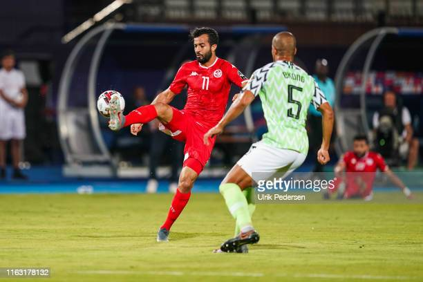 Taha Yassine Khnissi of Tunisia and William Paul Ekong of Nigeria during the 3rd place African Nations Cup match between Tunisia and Nigeria on 14th...