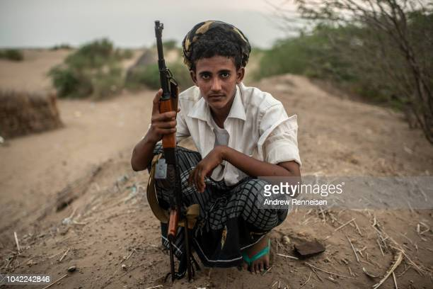 Tahami Resistance fighter a militia aligned with Yemen's Saudiled coalitionbacked government sits at a frontline east of the city on September 20...