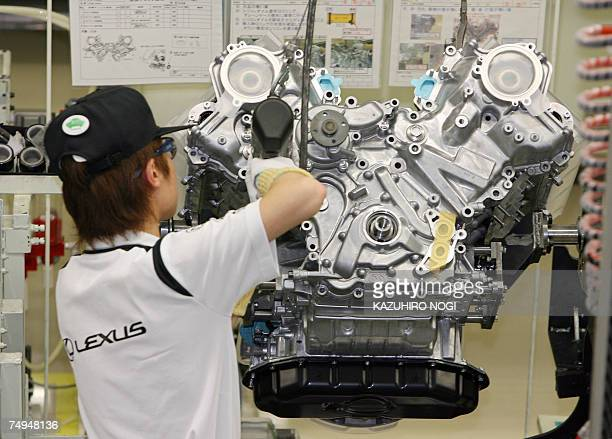 A worker at Japan's auto giant Toyota motor assembles an engine for LEXUS cars at the company's Tahara plant in Aichi prefecture 28 June 2007 670...