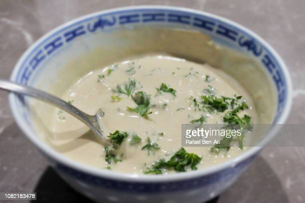 tahini sauce in a bowl - rafael ben ari stock-fotos und bilder