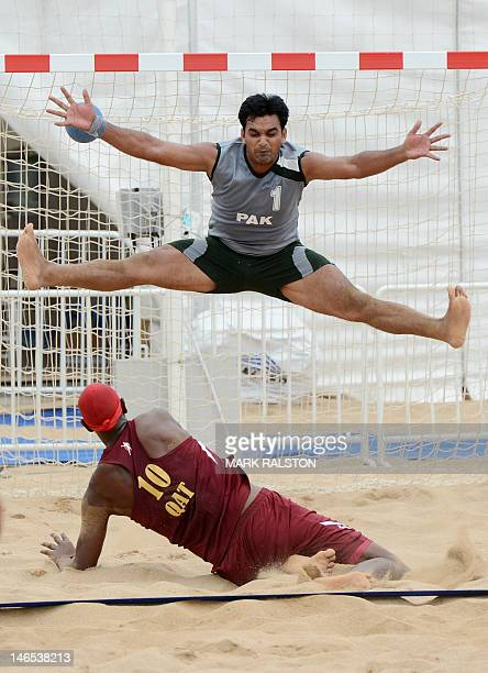 Tahir Ali of Pakistan fails to stop a goal by Ali Mohamed of Qatar during their men's beach handball match which Qatar won 20 at the 3rd Asian Beach...
