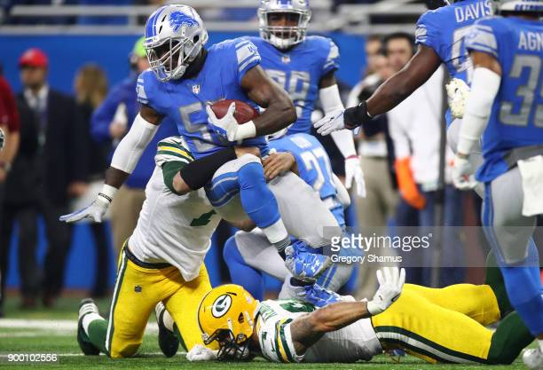 Tahir Whitehead of the Detroit Lions recovers a fumbler by quarterback Brett Hundley of the Green Bay Packers during the first half at Ford Field on...
