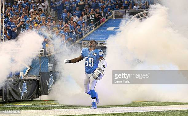 Tahir Whitehead of the Detroit Lions runs onto the field during player introductions prior to the start of the game against the Green Bay Packers at...