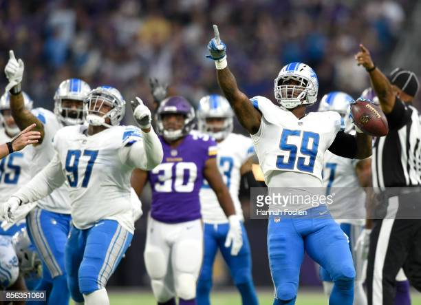 Tahir Whitehead of the Detroit Lions signals a turnover after recovering a fumble by Dalvin Cook of the Minnesota Vikings in the third quarter of the...