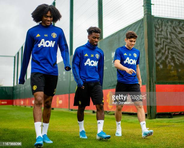Tahith Chong Angel Gomes and Daniel James of Manchester United in action during a first team training session at Aon Training Complex on August 14...