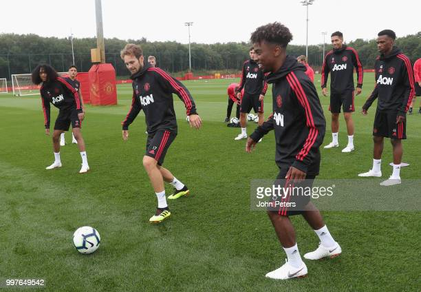 Tahith Chong Daley Blind and Angel Gomes of Manchester United in action during a first team training session at Aon Training Complex on July 13 2018...