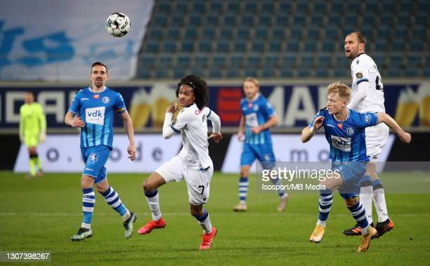 Tahith Chong of Club Brugge and Bas Dost of Club Brugge battle for the ball with Sven Kums of KAA Gent and Andreas Hanche-Olsen of KAA Gent during...