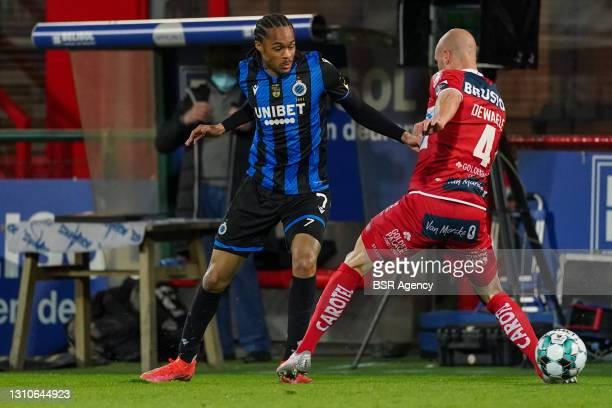 Tahith Chong of Club Brugge and Gilles Dewaele of KV Kortrijk during the Jupiler Pro League match between KV Kortrijk and Club Brugge at Guldensporen...