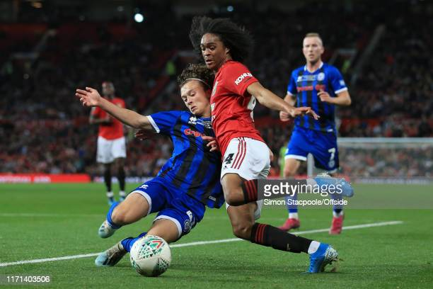 Tahith Chong of Man Utd battles with Luke Matheson of Rochdale during the Carabao Cup Third Round match between Manchester United and Rochdale AFC at...