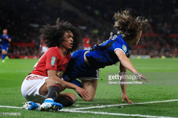 Tahith Chong of Man Utd clashes with Luke Matheson of Rochdale during the Carabao Cup Third Round match between Manchester United and Rochdale AFC at...
