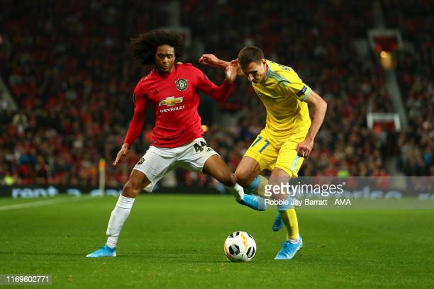 Tahith Chong of Manchester United and Dmitri Shomko of FC Astana during the UEFA Europa League group L match between Manchester United and FK Astana...