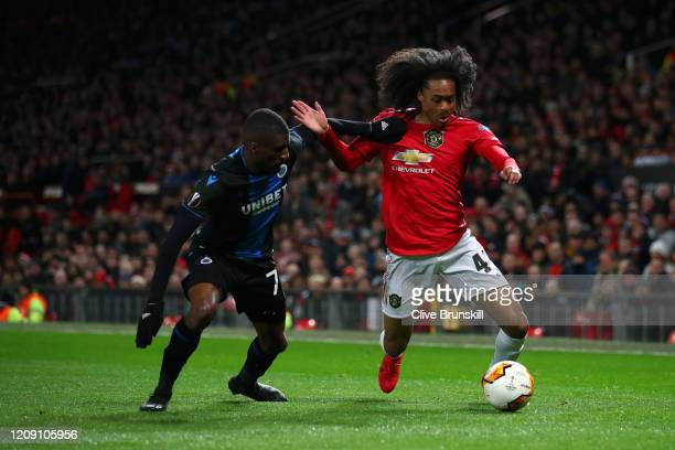Tahith Chong of Manchester United battles for possession with Clinton Mata of Club Brugge during the UEFA Europa League round of 32 second leg match...
