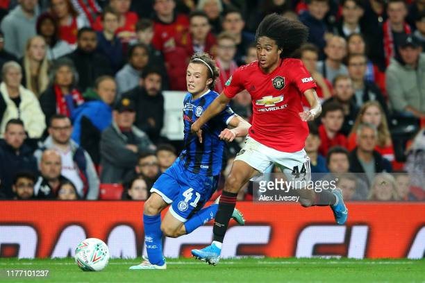 Tahith Chong of Manchester United battles for the ball with Luke Matheson of Rochdale during the Carabao Cup Third Round match between Manchester...
