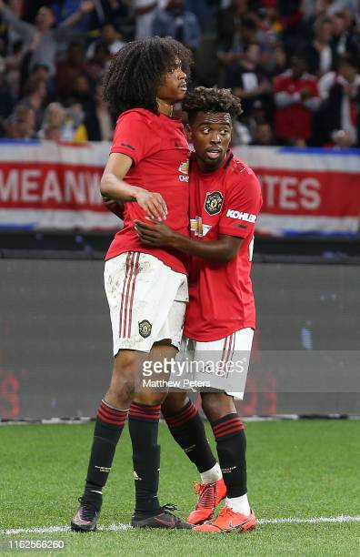 Tahith Chong of Manchester United celebrates winning a penalty during the pre-season friendly match between Manchester United and Leeds United at...