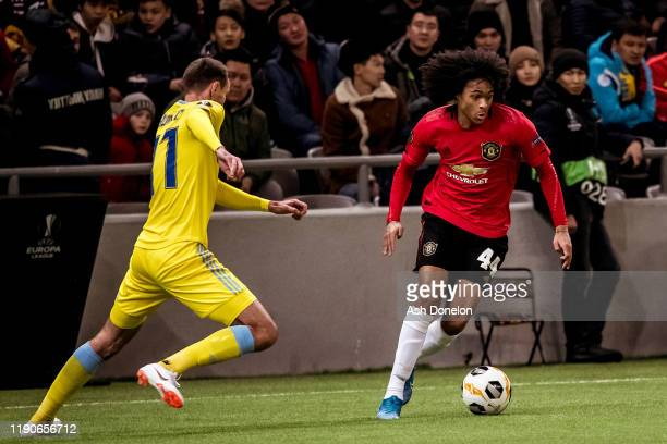 Tahith Chong of Manchester United in action with Dmitri Shomko of FK Astana during the UEFA Europa League group L match between FK Astana and...