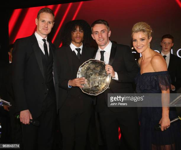 Tahith Chong of Manchester United is presented with the Jimmy Murphy Under18s Player of the Season award by U18s manager Kieran McKenna at the club's...