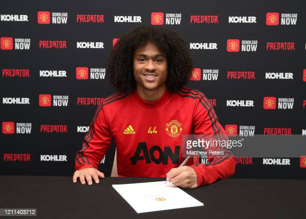 Tahith Chong of Manchester United poses after signing a new contract with Manchester United at Aon Training Complex on March 09, 2020 in Manchester,...