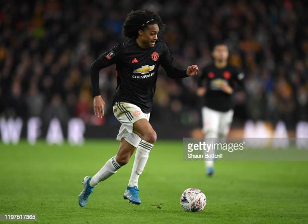 Tahith Chong of Manchester United runs with the ball during the FA Cup Third Round match between XX and XX at Molineux on January 04, 2020 in...
