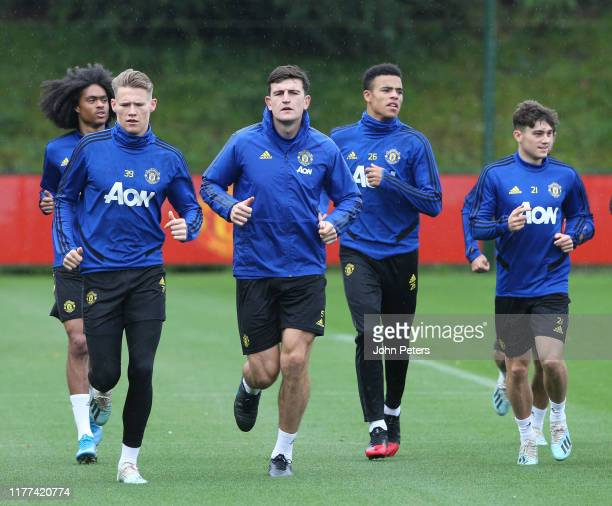 Tahith Chong Scott McTominay Harry Maguire Mason Greenwood Daniel James of Manchester United in action during a first team training session at Aon...