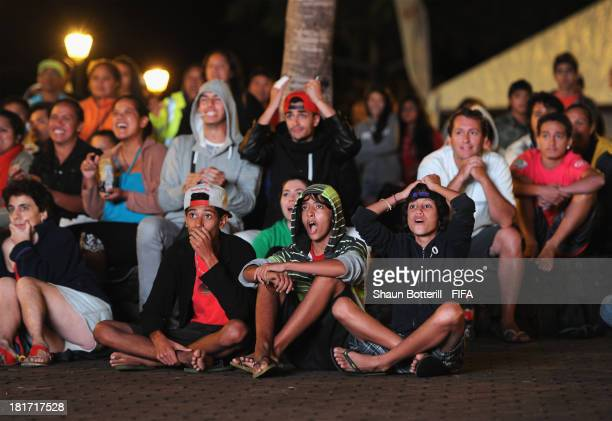 Tahiti fans watch the game in the fan zone during the FIFA Beach Soccer World Cup Tahiti 2013 Group A match between Tahiti and Spain at the Tahua...