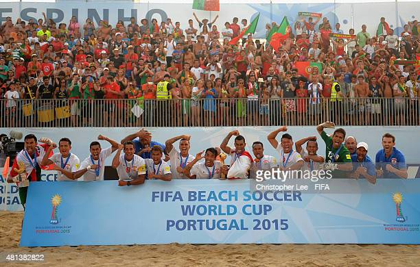 Tahiti team celebrate their second place with their medals during the FIFA Beach Soccer World Cup Final match between Tahiti and Portugal at Espinho...