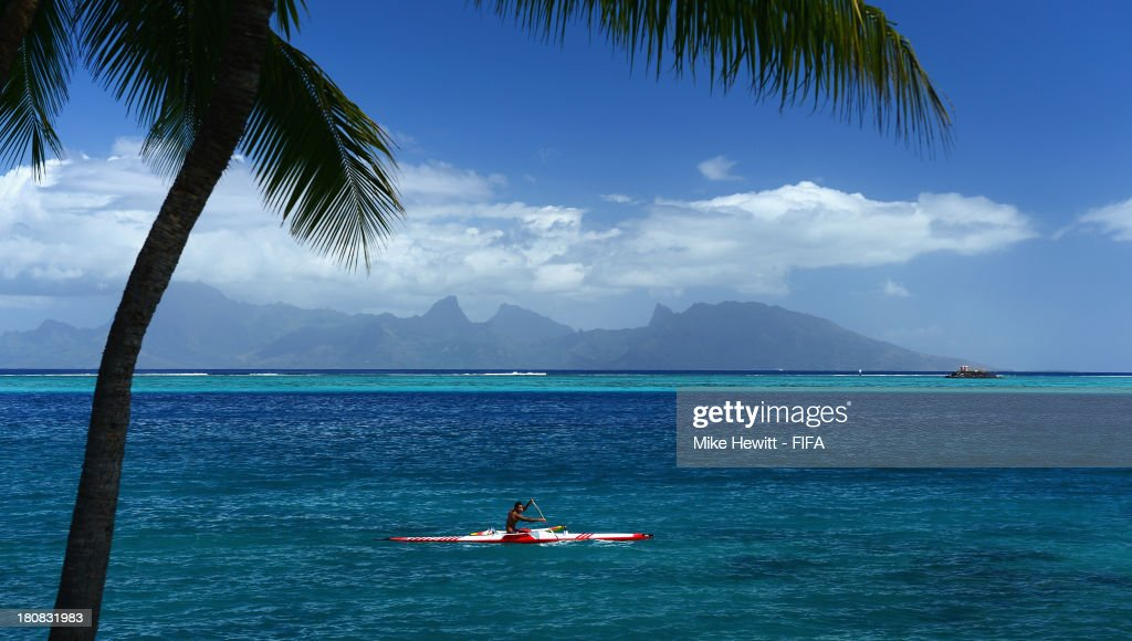 A Tahitian kayaks in front of the island of Moorea in Papeete, French Polynesia.