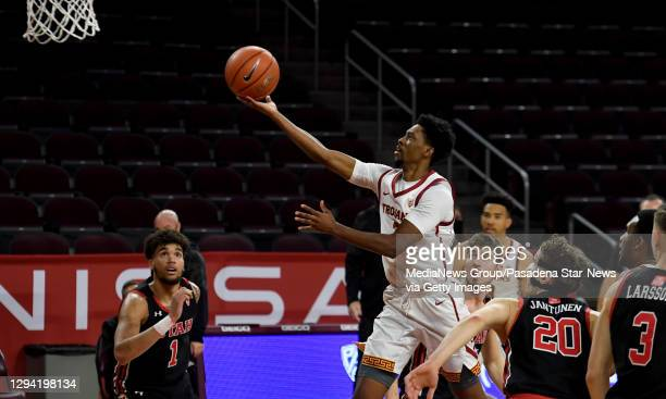 Tahj Eaddy of the USC Trojans drive to the basket against the Utah Utes in the first half of a NCAA basketball game at Galen Center on the campus of...