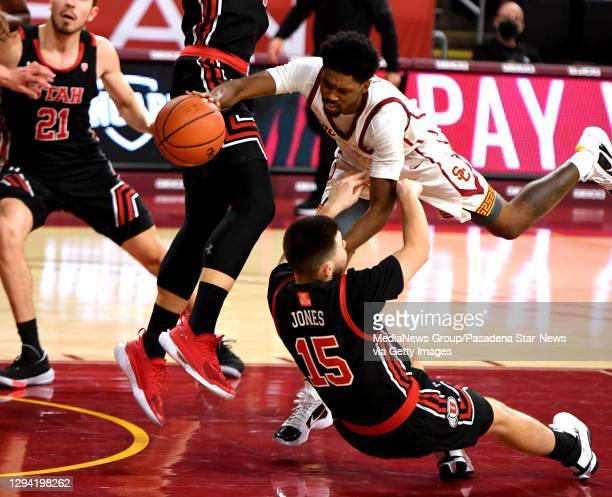 Tahj Eaddy of the USC Trojans drives to the basket against the Utah Utes In the first half of a NCAA basketball game at Galen Center on the campus of...