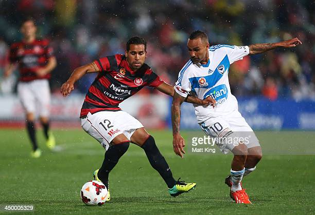 Tahj Minniecon of the Wanderers competes with Archie Thompson of the Victory during the round six ALeague match between the Western Sydney Wanderers...