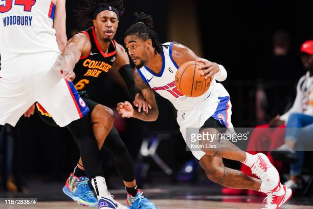Tahjere McCall of the College Park Skyhawks guards Jordan Bone of the Grand Rapids Drive during the third quarter an NBA GLeague game on December 8...