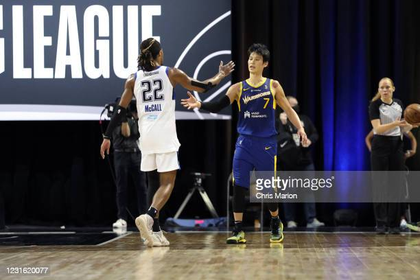 Tahjere McCall of the Lakeland Magic and Jeremy Lin of the Santa Cruz Warriors high five after the game during the NBA G League Playoffs on March 9,...