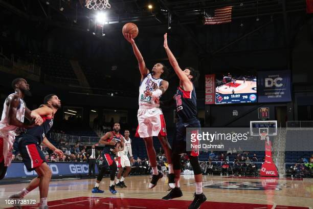 Tahjere McCall of the Long Island Nets shoots against Chris Chiozza of the Capital City GoGo during an NBA GLeague game at the Entertainment and...