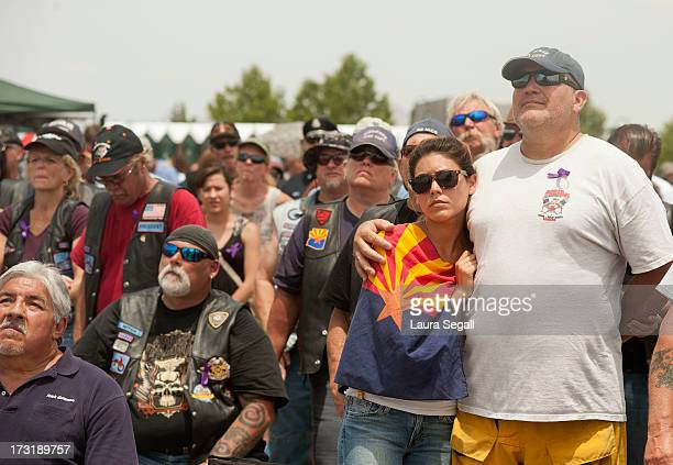 Tahlia Contreras from Los Angeles California leans her father Frank Contreras as she is draped in the Arizona State flag during a memorial service in...
