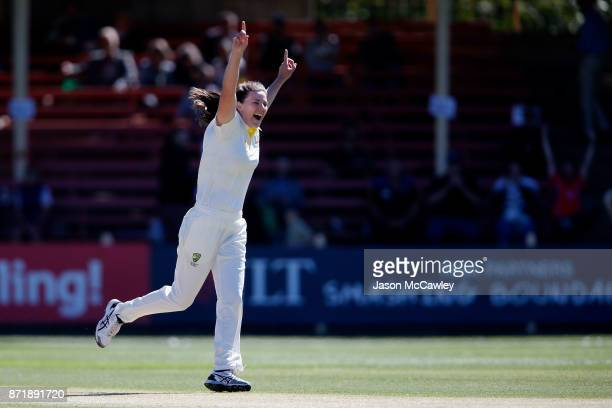 Tahlia McGrath of Australia celebrates after taking the wicket of Lauren Winfield of England during the Women's Test match between Australia and...