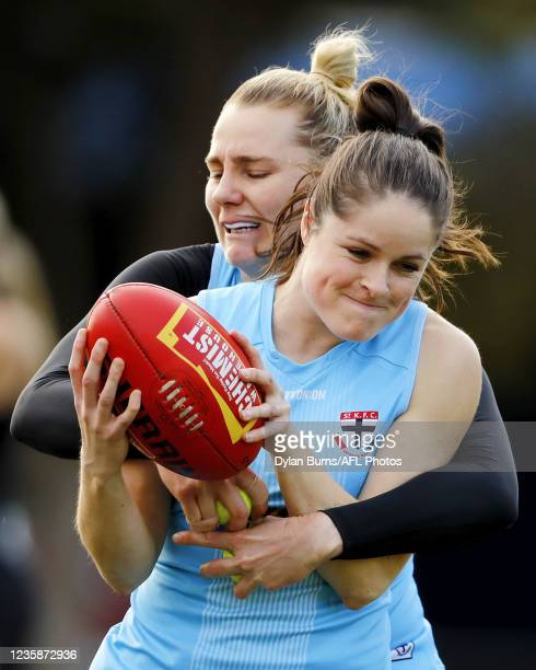 Tahlia Meyer of the Saints is tackled by Jacqui Vogt of the Saints during the St Kilda training session at RSEA Park on October 14, 2021 in...