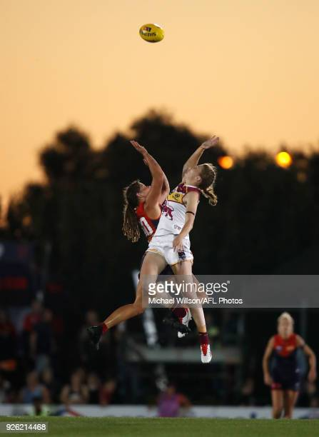 Tahlia Randall of the Lions and Richelle Cranston of the Demons compete in a ruck contest during the 2018 AFLW Round 05 match between the Melbourne...