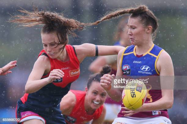 Tahlia Randall of the Lions crunches Sarah Lampard of the Demons during the round one Women's AFL match between the Melbourne Demons and the Brisbane...