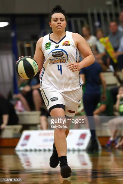 Tahlia Tupaea of the Flames dribbles the ball during the round two WNBL match between Dandenong and Sydney Uni on October 19, 2018 in Dandenong,...