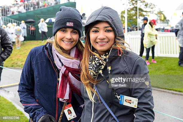 Tahnee Kirk left and Ipsa Lahiri watch Sundays singles matches during the final round of The Presidents Cup at Jack Nicklaus Golf Club Korea on...